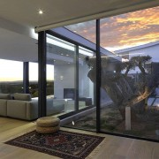 Slimline sliding doors show off stunning sunset