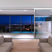 Slimline sliding doors show off night time view